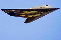 stealth jet in flight with W S O markings visible